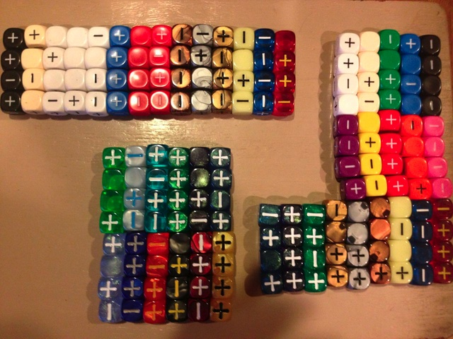 [Image of a large fate dice collection]